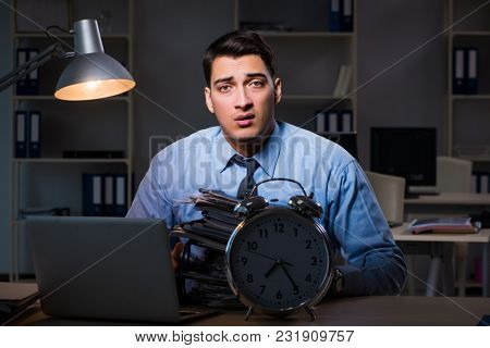 Young employee working overtime to meet deadline