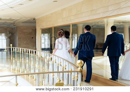 Young Wedding Couple Near The Mirror Two