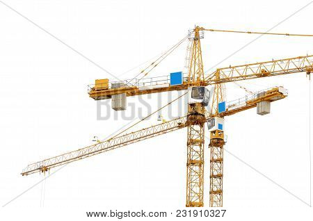 Construction Crane On White Background.it Is Used To Lift Loads At The Construction Site.