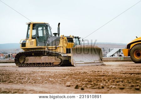 Industrial Building Construction Site Mini Bulldozer Levelling And Moving Soil During Highway Buildi