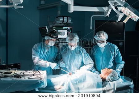 View Of Multicultural Surgeons And Patient During Surgery