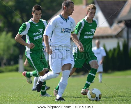 KAPOSVAR, HUNGARY - SEPTEMBER 5: Daniel Pager (white 3) in action at the Hungarian National Championship under 19 game Kaposvar (white) vs. Nagyatad (green) September 5, 2011 in Kaposvar, Hungary.