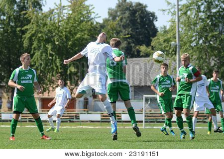 KAPOSVAR, HUNGARY - SEPTEMBER 5: Daniel Vaszilko (white 11) in action at the Hungarian National Championship under 19 game Kaposvar (white) vs. Nagyatad (green) September 5, 2011 in Kaposvar, Hungary.