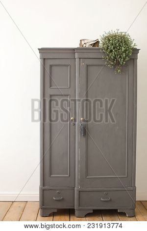 Gray Old Vintage Cupboard In White Interior. Wooden Wardrobe Architecture, Interiors Of Empty Apartm