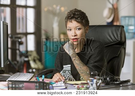 Confident Professional Woman At Desk In Her Office