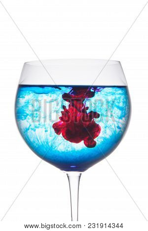 Food Coloring Diffuse In Water Inside Wine Glass Area For Slogan Or Advertising Text Message, Isolat