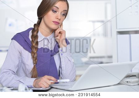 Portrait Of Young Attractive Woman Working In Office