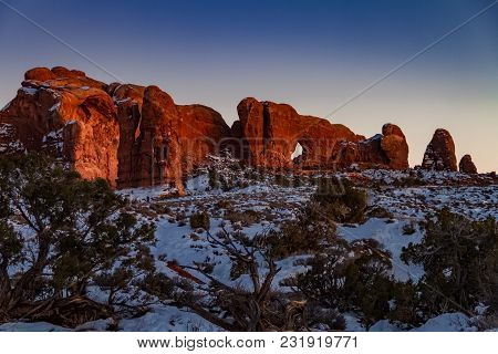 Pristine Winter Sunset View Of Skyline Arch With Snow In Arches National Park In Moab, Utah