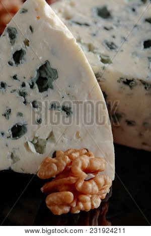 Wedges Of Soft Blue Cheese With Walnuts.