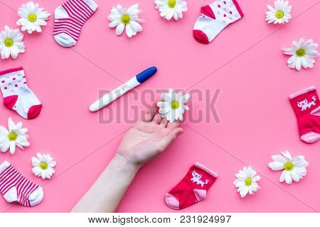 Pregnancy And Preparation For Childbirth. Pregnancy Test Near Flowers On Pink Background Top View Sp