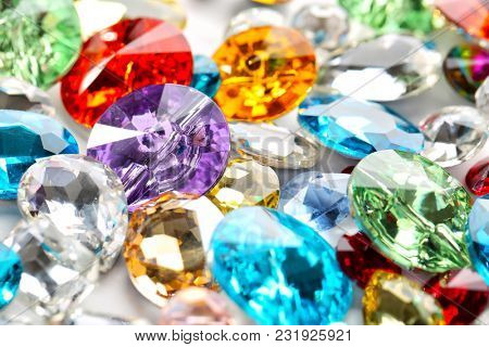Colorful precious stones for jewellery on table