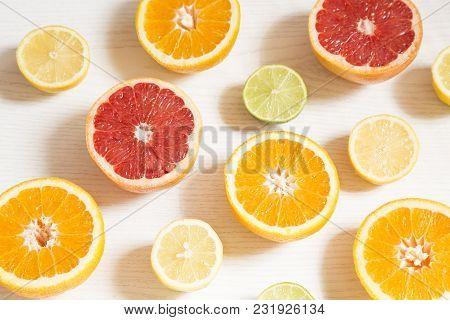 Orange And Lemon Halves On White Background