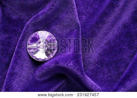 Precious stone for jewellery on purple velvet