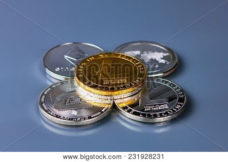 Physical Version Of Litecoin, New Virtual Money. Conceptual Image For Worldwide Cryptocurrency And D