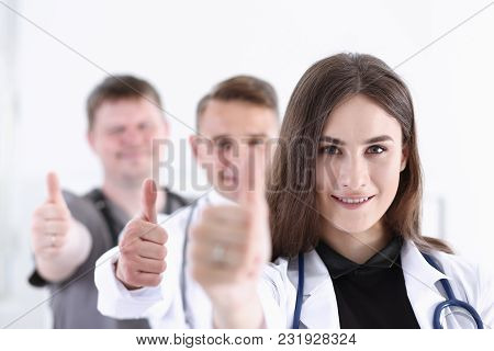 Group Of Doctor Show Ok Or Approval Sign With Thumb Up Portrait. High Level Service, Best Treatment