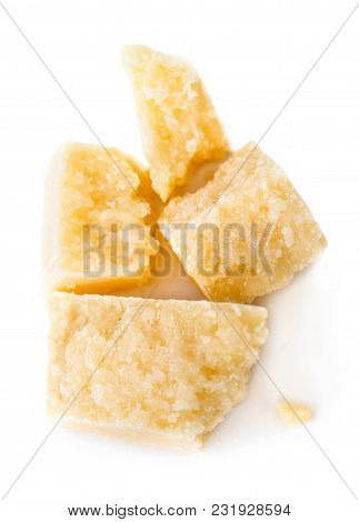 Parmesan Cheese Pieces Isolated On White Background. Italian Hard Mature Cheese Slices. Top View