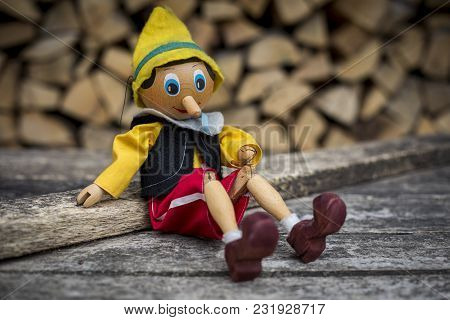 Old Wooden Pinocchio Pupett . Retro Marionette Toy