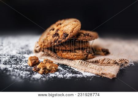 Chocolate Cookies On Linen Napkin On Black Background. Chocolate Chip Cookies Shot Close-up