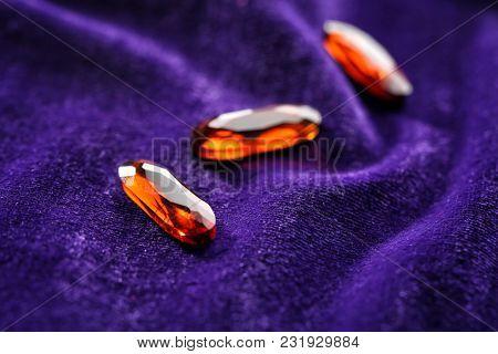 Precious stones for jewellery on purple velvet