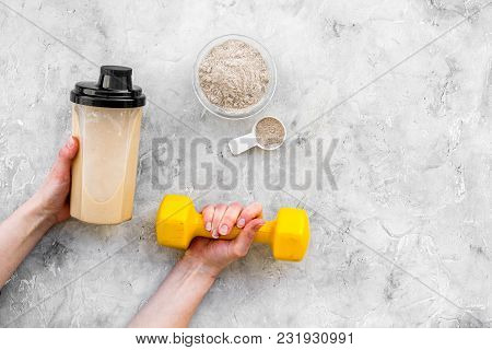 Protein Powder For Fitness Nutrition To Start Training And Bars On Gray Desk Background Top View Moc