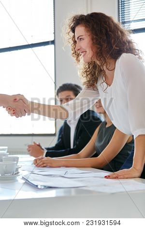 Businesswoman is congratulated for her success