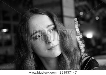 Cute Girl Is Sitting In The Cafe. She Has Big Brown Romantic Eyes. With Nice Brown Long Hair. Wearin