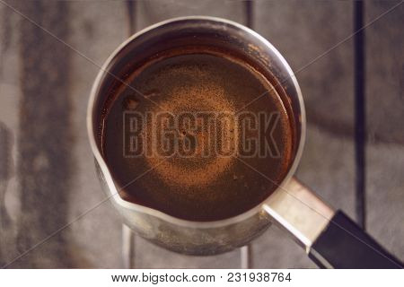 Circles On The Surface Of Black Coffee Brewed In Coffee Pot, Soft Focus, Toned