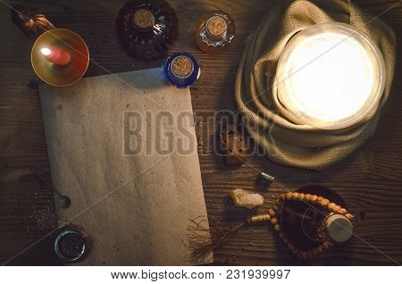 Crystal Ball And Ancient Magic Blank Scroll Page With Copy Space On Fortune Teller Magic Desk Table