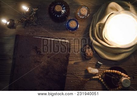 Crystal Ball And Magic Book With Copy Space On Fortune Teller Magic Desk Table Background. Seance Co