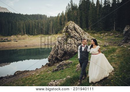 Beautiful Couple Of Newlyweds Against The Backdrop Of The Mountains In Italy