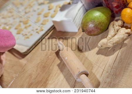 Wooden Rolling Pin On Kitchen Table After Preparing Dough For Cookies
