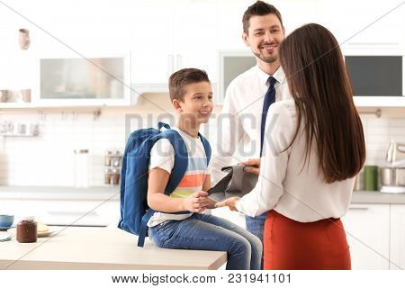 Parents helping their son get ready for school