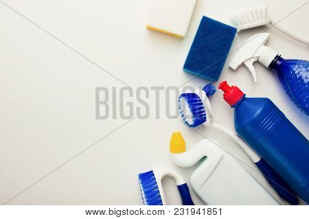House Cleaning Products And Supplies On White Isolated Background, Top View. Spring Cleaning And Hou