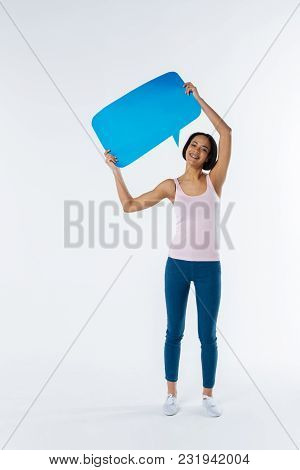 Rights Protection. Joyful Happy Woman Holding A Blue Sign And Smiling While Taking Part In The Socia