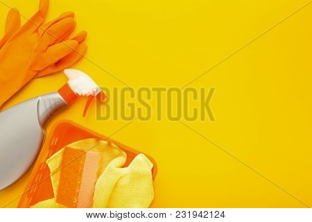 Set Of Orange House Cleaning Products And Supplies On Yellow Isolated Background, Top View. Spring C