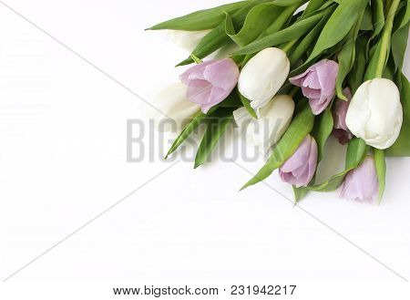 Spring Styled Stock Photo. Easter Concept. Feminine Desktop Scene With Bouquet Of White And Violet T