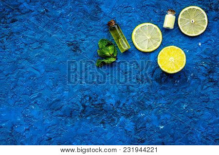 Natural Cosmetics Set With Fresh Lemon And Organic Oil On Blue Table Background Top View Mock Up.