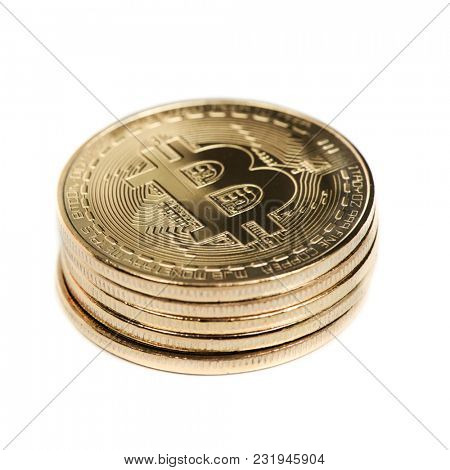 closeup of a pile of bitcoins on a white background