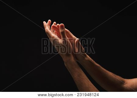 Outstretched Male Hands, Man Keeping Empty Cupped Palms Together Isolated On Studio Black Background