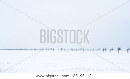 The Road In The Snow In A Flat Land