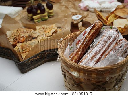 Wedding Table Decorated With Confectionery. Eclairs, Marshmallows