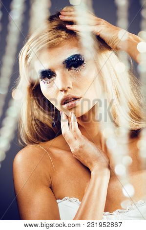 Beauty Young Snow Queen Lady In Fairy Flashes With Hair Crown On Her Head Close Up In Cold Blue Ligh