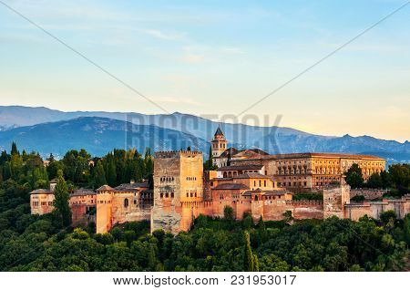 Granada, Spain. Aerial View Of Alhambra Palace In Granada, Spain With Sierra Nevada Mountains At The