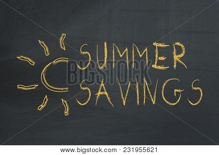 Summer Savings Text And A Drawn Sunny On Chalkboard