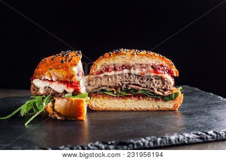 Homemade Burgers With A Cutlet Of Turkey, Cranberry Sauce And Salad. View On The Forehead.