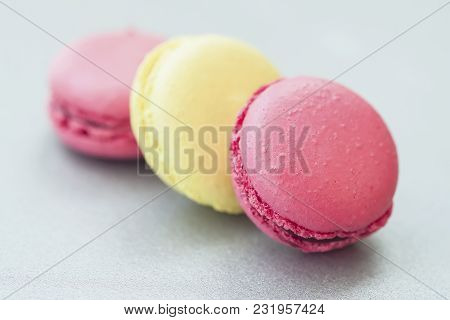Three Colorful Macaroons, French Sweet Delicacy Close-up