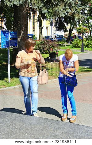 Chernihiv / Ukraine. 28 August 2016: Two Modern Women Friends Walk Around The City. Female Friendshi