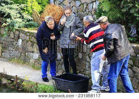 Kosiv Ivano-frankivsk Region/ Ukraine - 27 October 2017 / Ukraine: Man Showing Caught Sterlet To Wom