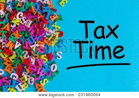 Tax Time - Message On An Office Desk With Many Little Letters.