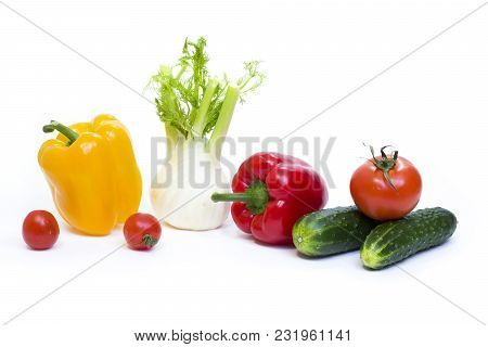 Red Pepper With Yellow Pepper And Tomatoes On A White Background. Cucumbers With Peppers And Tomatoe